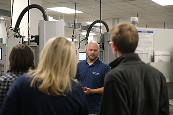 CNC Machine Tool instructor answers questions during Open House.jpg