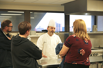 Culinary Arts Chef answers questions at Open House.jpg