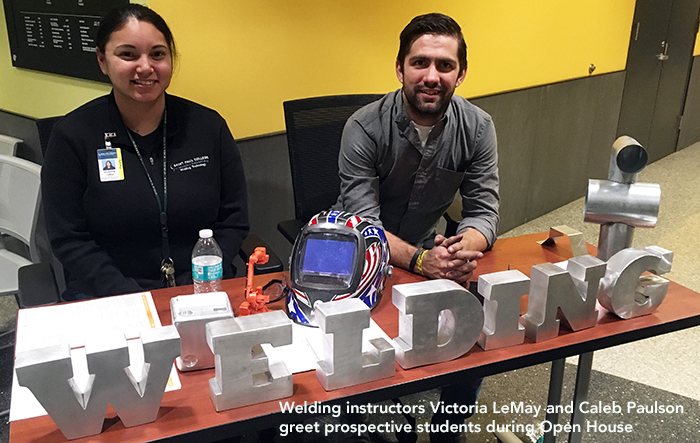 welding instructors greet prospective students